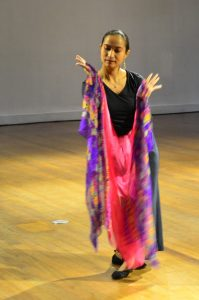 Louanne Calipayan dancers with a scarf.