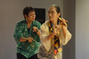 "The militant song ""Mga Babae"" is danced with bula'bula using bamboo clappers, by CB Garrucho and Ligaya Amilbangsa."